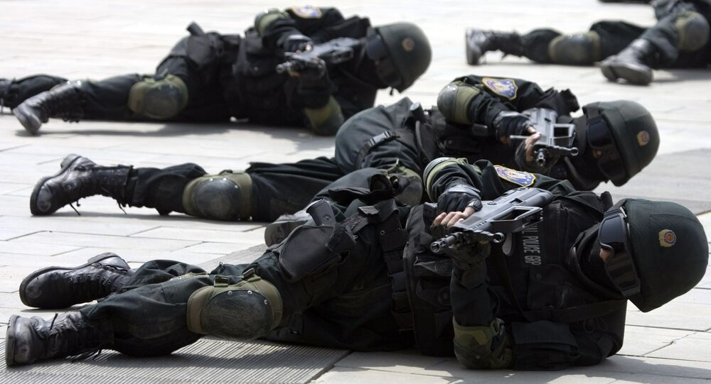 Special police forces demonstrate their craft during a drill to mark the launch of a training program on Beijing Olympic Games security held at the Beijing People's Police Institute on the outskirts of Beijing, China. file photo