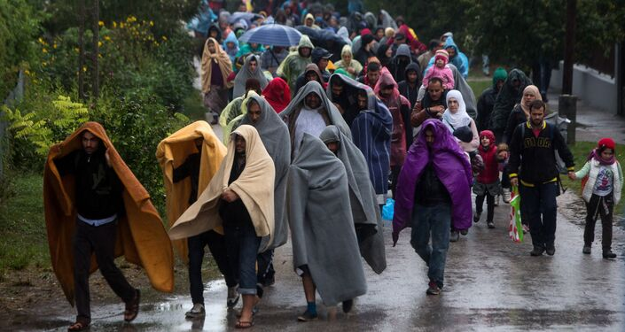Refugees walk from railway station in Hegyeshalom in Hungary toward the Austrian border.