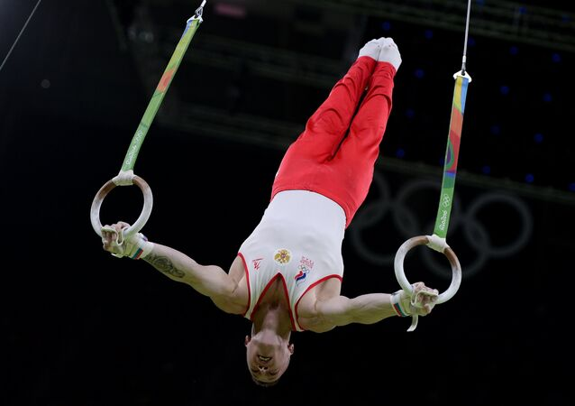 Denis Ablyazin (Russia) performs his still rings routine during the qualifying round of the men's artistic gymnastics competition at the XXXI Summer Olympics
