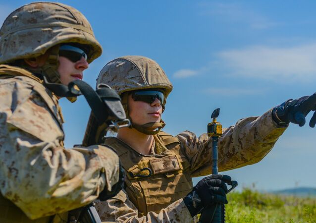 Second Lt. Virginia Brodie points out an enemy position to 2nd Lt. Katherine Boy at the Field Artillery Basic Officers Leadership Course at Fort Sill, Oklahoma.