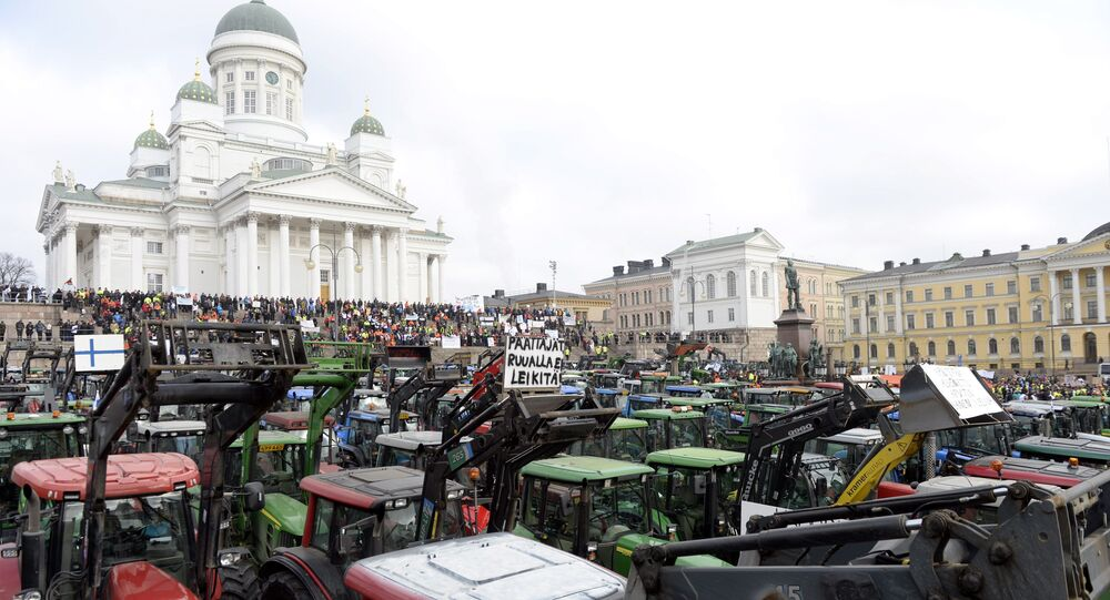Farmers with their tractors from different parts of the country participate in a demonstration in Helsinki, Finland, Friday, March 11, 2016.