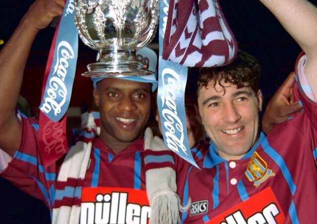 Britain Football Soccer - Aston Villa v Manchester United - Coca Cola Cup Final - 27/3/94 Aston Villa's Dalian Atkinson and Dean Saunders celebrate with the trophy