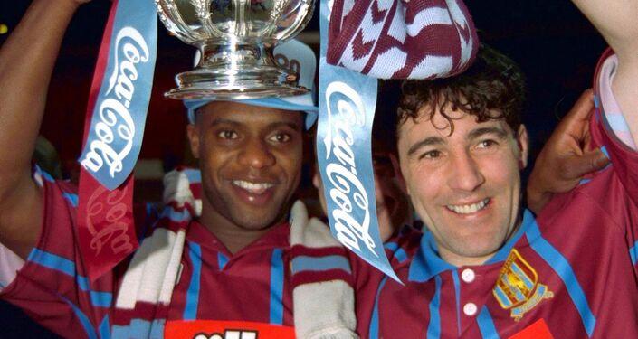 Britain Football Soccer - Aston Villa v Manchester United - Coca Cola Cup Final - 27/3/94 Aston Villa's Dalian Atkinson and Dean Saunders celebrate with the trophy