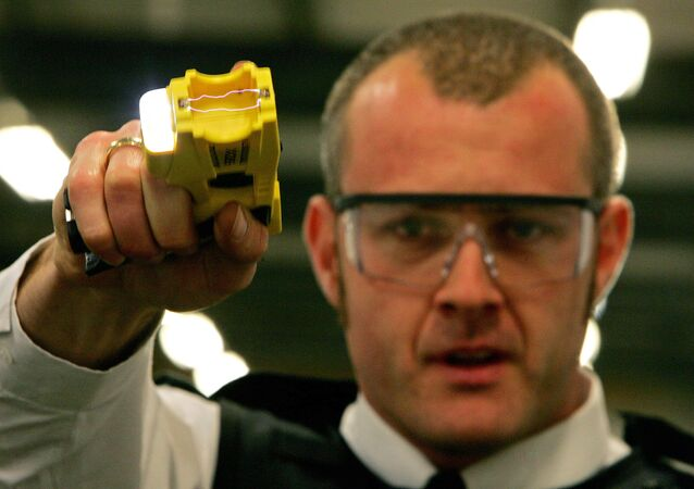 British Police Officer and a taser gun