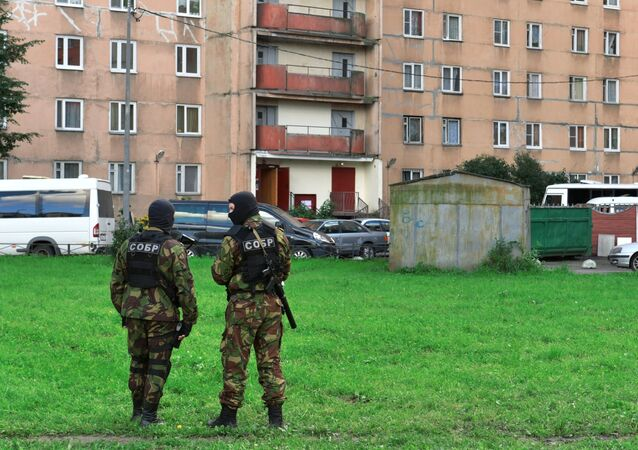 Special task force outside a residential high-rise during an operation to detain alleged North Caucasus militants, in St. Petersburg