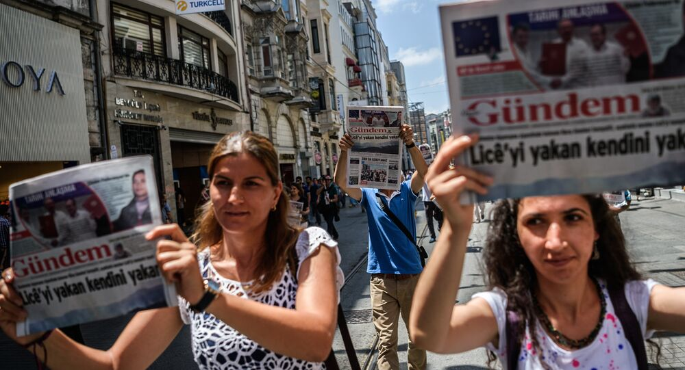Demonstrators hold copies of pro-Kurdish newspaper Ozgur Gundem as they a protest against the arrest of three prominent activists for press freedom in Istanbul. (File)