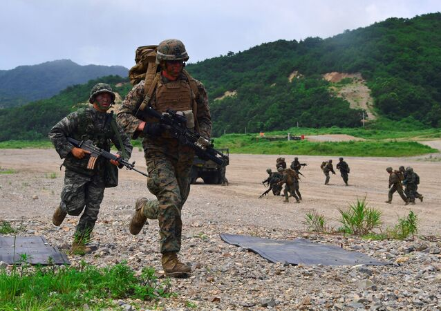 South Korea and US Marines run to a position during a joint military drill at a fire training field in the southeastern port of Pohang on July 6, 2016