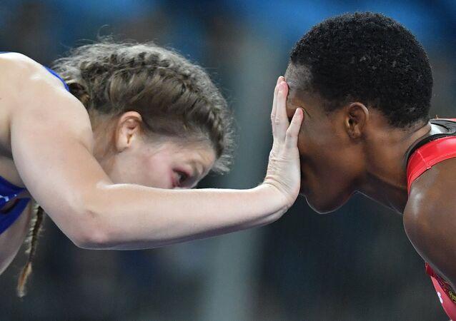 Female wrestler Ekaterina Bukina won bronze in women's freestyle 75 kg defeating Annabel Laure Ali from Cameroon.