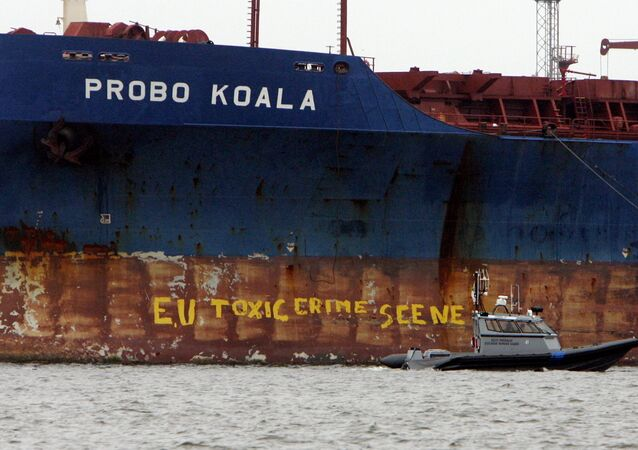 A police ship patrols near the Panamanian-registered vessel Probo Koala, suspected of dumping toxic waste in waters off Ivory Coast