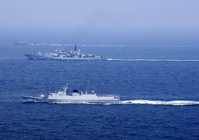 Chinese naval vessels participate in a drill on the East China Sea, China, August 1, 2016. Picture taken August 1, 2016