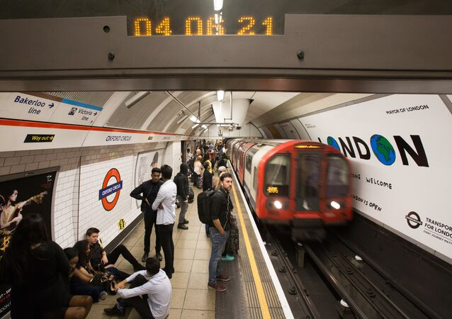 A London Underground train arrives at Oxford Circus station in central London on August 20, 2016, following the launch of the 24 hour night tube service