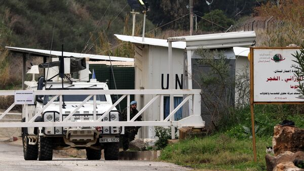 A Spanish soldier of the United Nations Interim Forces in Lebanon (UNIFIL) guards a checkpoint in southern Lebanese village of Wazzani next to the divided village of Ghajar on border with Israel on January 5, 2016 - Sputnik International