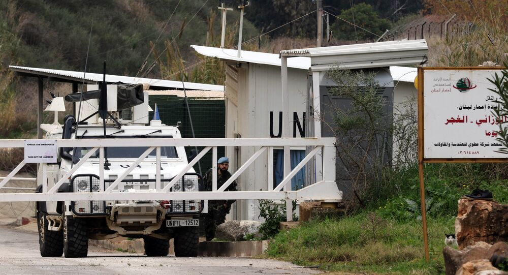 A Spanish soldier of the United Nations Interim Forces in Lebanon (UNIFIL) guards a checkpoint in southern Lebanese village of Wazzani next to the divided village of Ghajar on border with Israel on January 5, 2016
