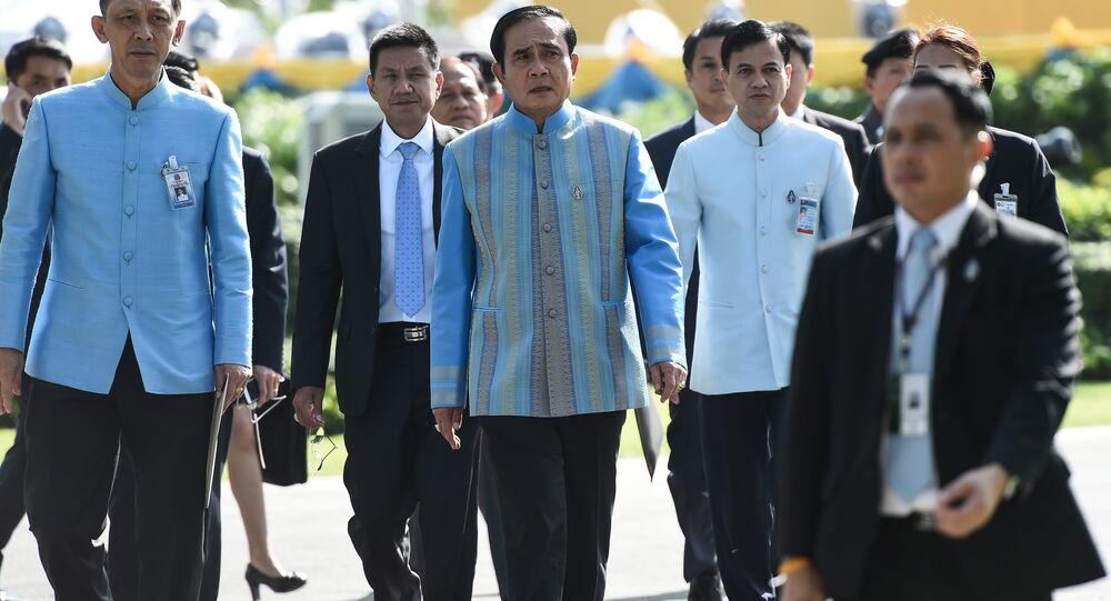 Prime Minister Prayuth Chan-Ocha (C) arrives at Government House before a cabinet meeting in Bangkok on August 9, 2016