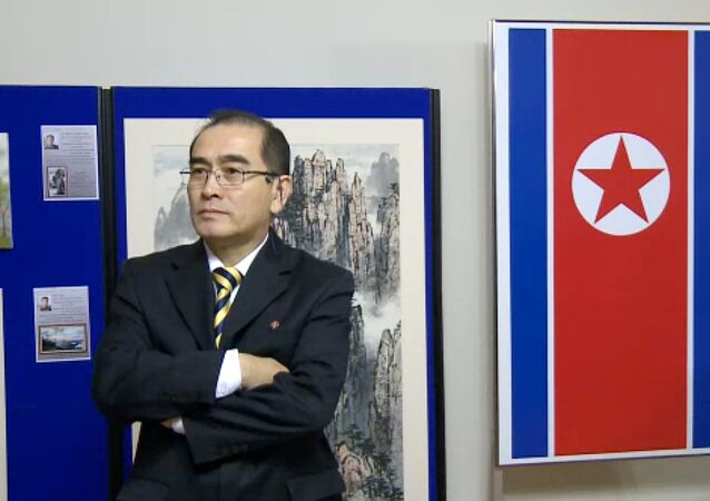 In a video grab created on August 17, 2016 taken from footage recorded by AFPTV on November 3, 2014 deputy ambassador at the North Korean embassy in London, Thae Yong-ho, stands in front of an artwork during a photocall to view an exhibition of North Korean art at the North Korean embassy in west London