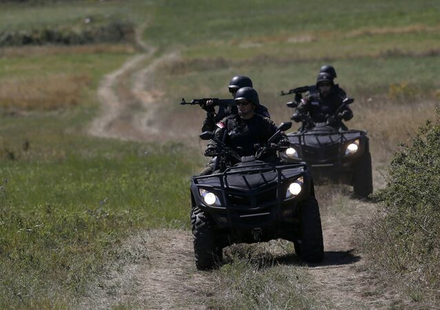 Serbian officers patrol near the border between Serbia and Bulgaria, not far from the border crossing Vrska Cuka, some 250 km (155 miles) southeast of Belgrade, Serbia, Monday, Aug. 15, 2016