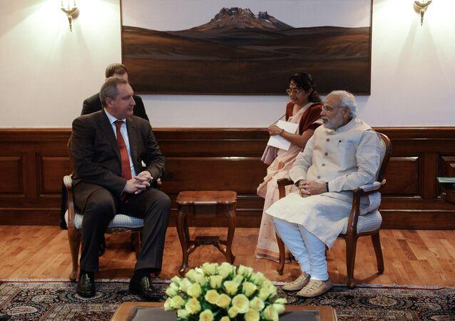 Russian Deputy Prime Minister Dmitry Rogozin, left, and Indian Prime Minister Narendra Modi during talks in New Delhi. File photo