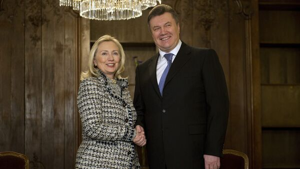 US Secretary of State Hillary Clinton shaking hands with Ukrainian President Viktor Yanukovych during a bilateral meeting at the 48th Munich Security Conference, 2012. Two years earlier, Clinton traveled to Ukraine directly to meet with the president. - Sputnik International