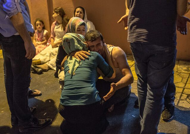 Relatives grieve at hospital August 20, 2016 in Gaziantep following a late night militant attack on a wedding party in southeastern Turkey