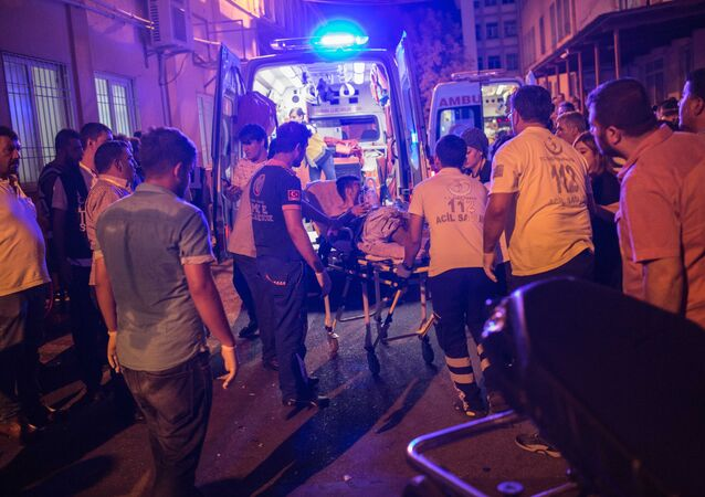 First aid officers carry an injured man to hospital August 20, 2016 in Gaziantep following a late night militant attack on a wedding party in southeastern Turkey