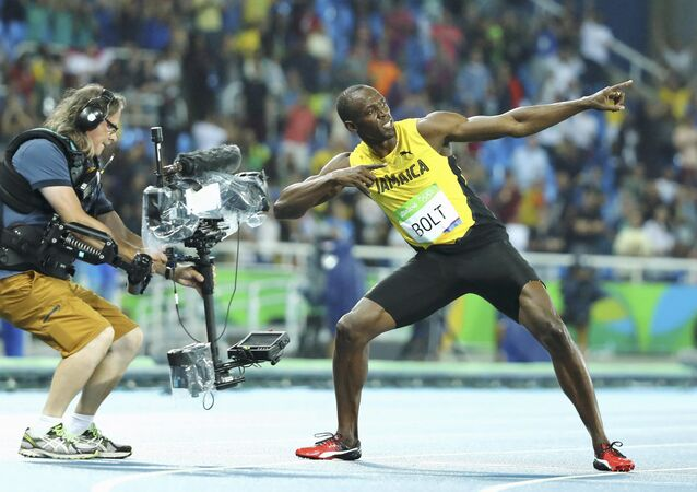 2016 Rio Olympics - Athletics - Final - Men's 200m Final - Olympic Stadium - Rio de Janeiro, Brazil - 18/08/2016. Usain Bolt (JAM) of Jamaica poses after winning the gold