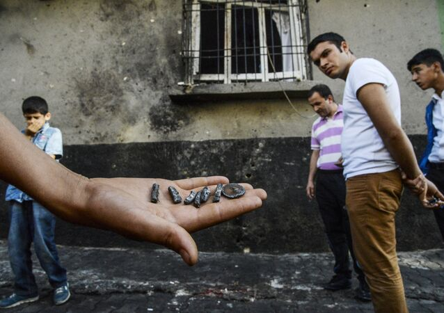 A person shows pieces of projectile near the explosion scene following a late night attack on a wedding party that left at least 30 dead in Gaziantep in southeastern Turkey near the Syrian border on August 21, 2016