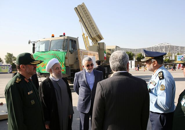 Iran's President Hassan Rouhani (2nd L) and Defence Minister Hossein Dehghan (L) stand near the new air defense missile system Bavar-373, in Tehran, Iran August 21, 2016