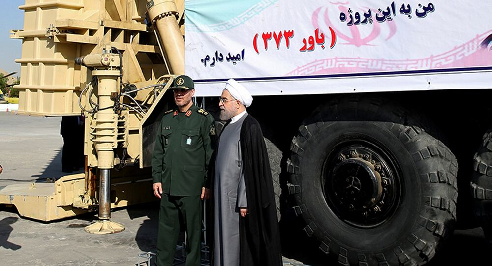 Iran's President Hassan Rouhani (R) and Defence Minister Hossein Dehghan stand in front of the new air defense missile system Bavar-373, in Tehran, Iran August 21, 2016