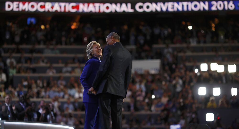 U.S. President Barack Obama and Democratic presidential nominee Hillary Clinton appear onstage together after his speech on the third night at the Democratic National Convention in Philadelphia, Pennsylvania, U.S. July 27, 2016