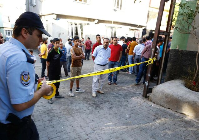 A police officer secures the scene of an explosion where a suspected suicide bomber targeted a wedding celebration in the Turkish city of Gaziantep, Turkey, August 21, 2016