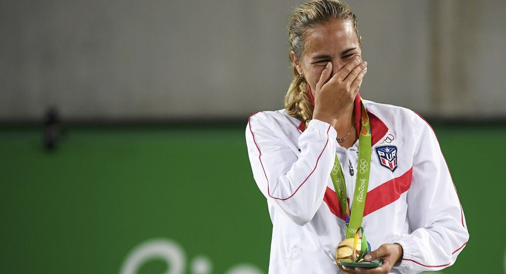 2016 Rio Olympics - Tennis - Victory Ceremony - Women's Singles Victory Ceremony - Olympic Tennis Centre - Rio de Janeiro, Brazil - 13/08/2016. Gold medalist Monica Puig (PUR) of Puerto Rico reacts after receiving her medal