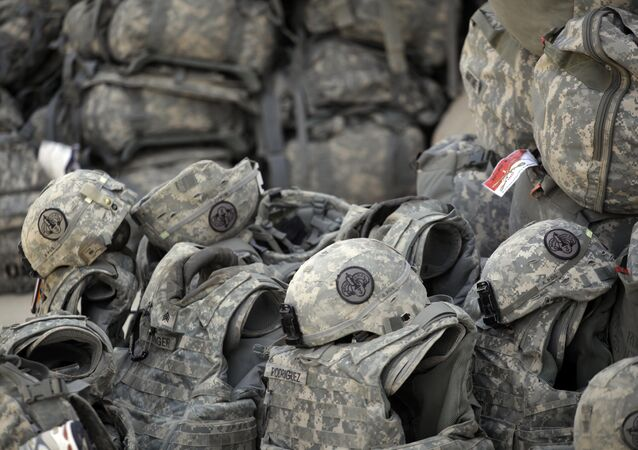 Helmets and body armor are are stacked and ready to go outside the passenger terminal at Sather Air Base in Baghdad, Iraq, for U.S. Army soldiers from the 3rd Armored Cavalry Regiment to begin their journey home to the United States after a yearlong deployment (File)