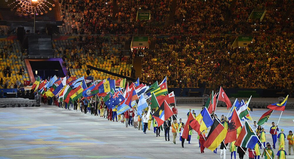 Athletes parade during the closing ceremony of the Rio 2016 Olympic Games at the Maracana stadium in Rio de Janeiro on August 21, 2016.