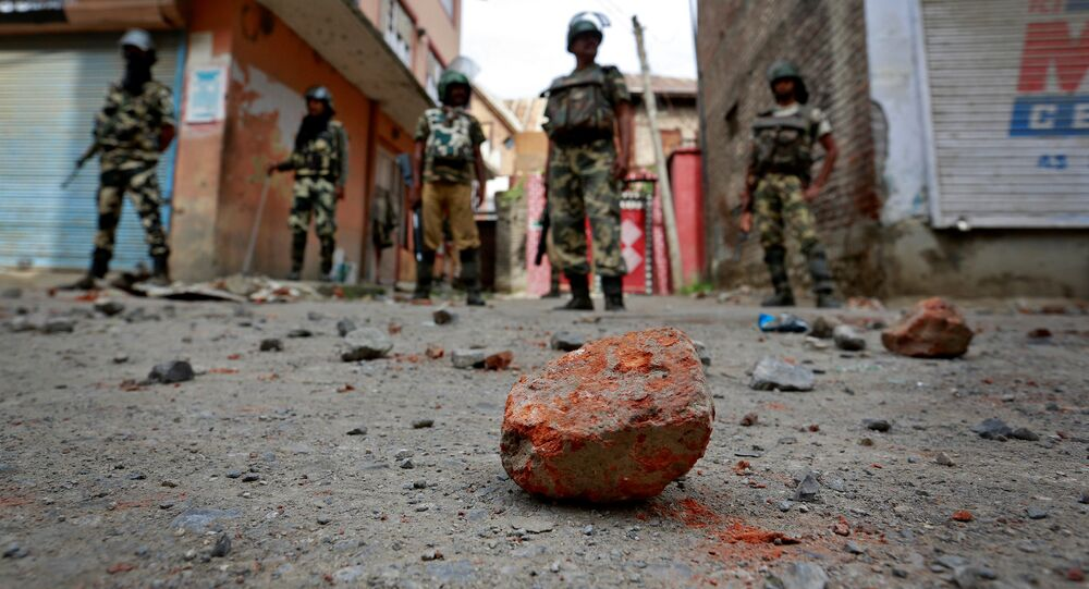 Stones thrown by protestors litter the street in Srinagar as security forces enforce a curfew following weeks of violence in Kashmir, August 18, 2016
