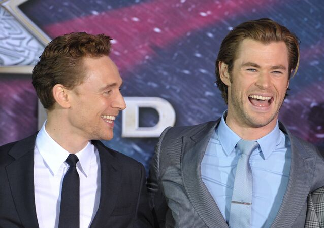Tom Hiddleston, left, and Chris Hemsworth arrive at the U.S. premiere of Thor: The Dark World at the El Capitan Theatre on Monday, Nov. 4, 2013, in Los Angeles