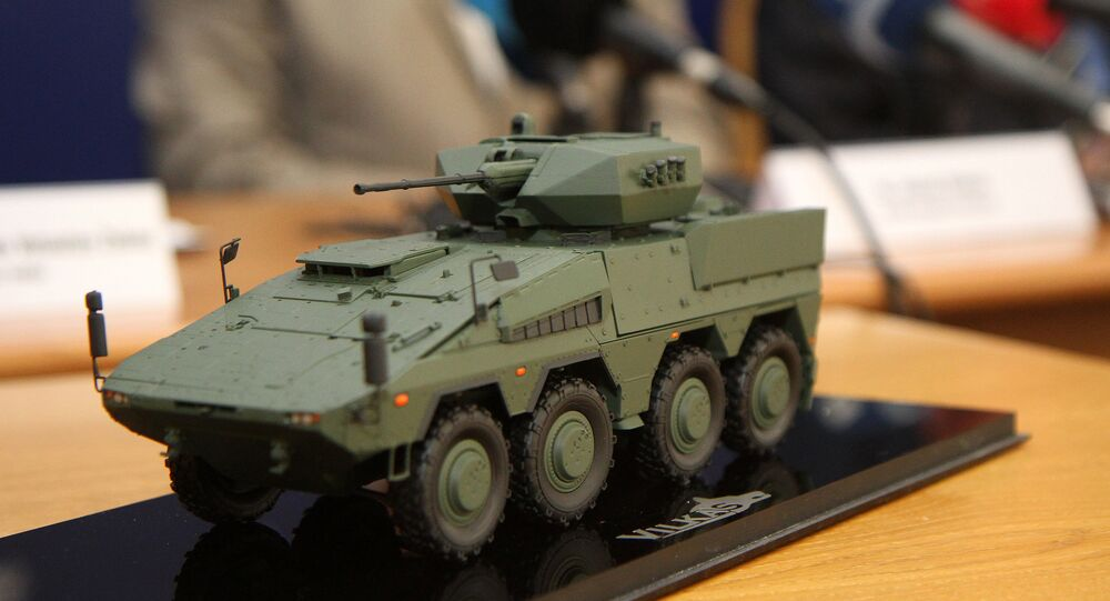 A model of the Boxer infantry fighting vehicles (IFV) is pictured during a press conference at the Ministry of National Defence in Vilnius, Lithuania, on August 22, 2016