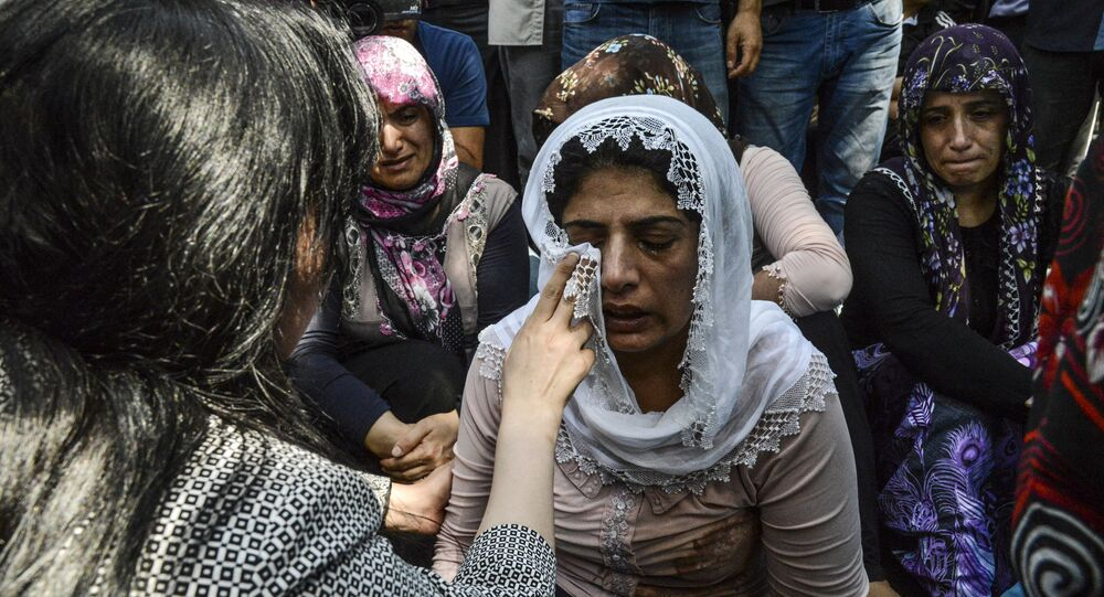 Women cry during a funeral for victims of last night's attack on a wedding party that left 50 dead in Gaziantep in southeastern Turkey near the Syrian border on August 21, 2016