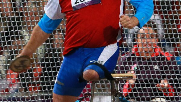Russian wheelchair athlete Alexei Ashapatov during the discus throw event at the 2012 London Paralympics. He won the gold medal and set a new world record - Sputnik International