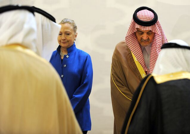 Saudi Foreign Minister Prince Saud Al-Faisal (R) escorts US Secretary of State Hillary Clinton as they arrive for a group picture with other Gulf counetrparts during their meeting in the Saudi capital of Riyadh, on March 31, 2012