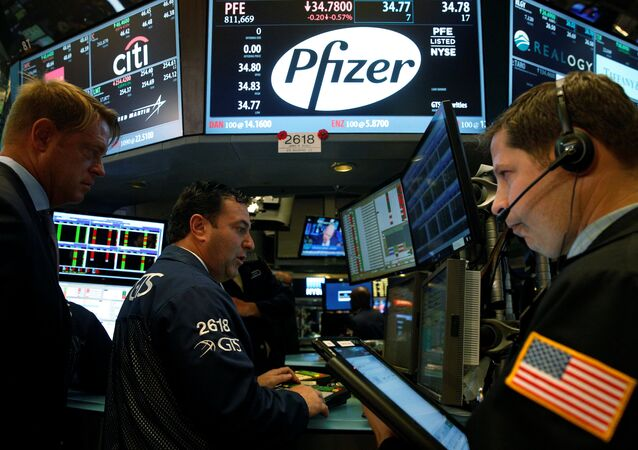 Traders gather at the post of Pfizer on the floor of the New York Stock Exchange (NYSE) in New York City, U.S., August 22, 2016