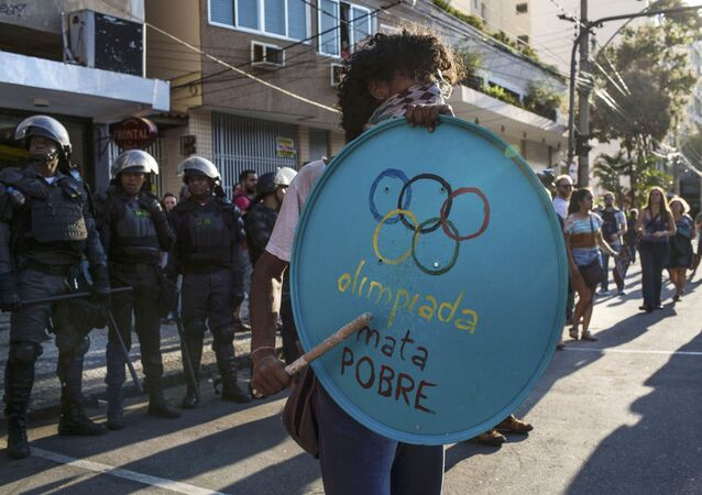 016 Rio Olympics - Opening Ceremony - Maracana - Rio de Janeiro, Brazil - 05/08/2016. Protester stands in front of riot police during demonstration against the Olympic Games near the Maracana stadium