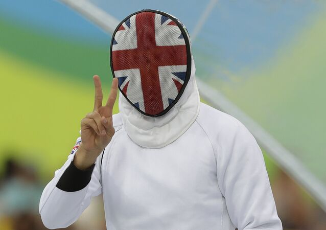 Joseph Choong of Britain gestures after competing in the fencing portion of the men's modern pentathlon at the Summer Olympics in Rio de Janeiro