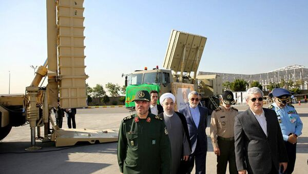 Iran's President Hassan Rouhani (3rd L) is seen against a backdrop of the Bavar-373 missile systems. File photo  - Sputnik International