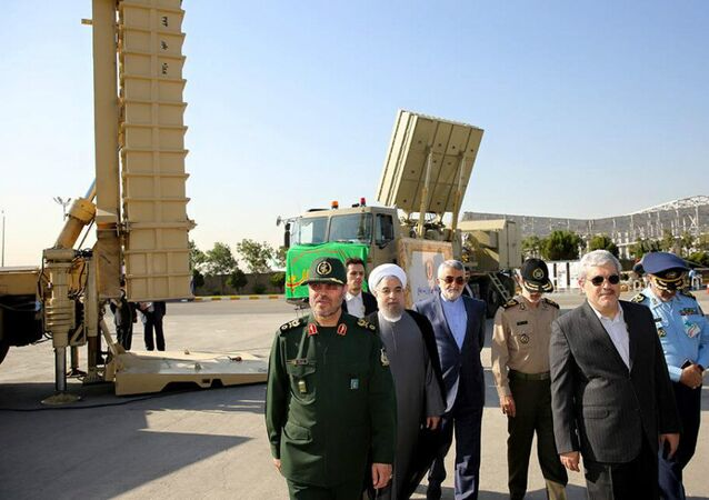 Iran's President Hassan Rouhani (3rd L) is seen against a backdrop of the Bavar-373 missile systems. File photo