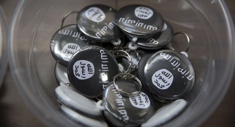 Islamic State group pins are on display at an Islamic bookstore where books about Islam, militant Islamic leaders and Islamic flags are displayed in the Fatih district of Istanbul, Monday, Oct. 13, 2014