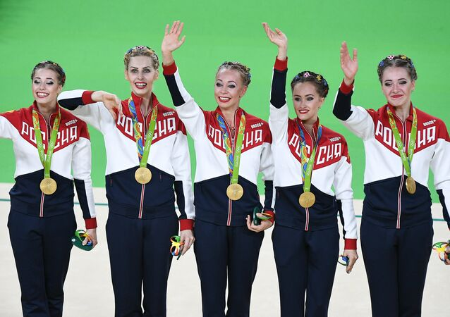 Russia's Vera Biryukova, Anastasia Bliznyuk, Anastasia Maksimova, Anastasia Tatareva and Maria Tolkacheva, gold medalists in the rhythmic gymnastics group all-around competition at the XXXI Summer Olympics, during the medal ceremony