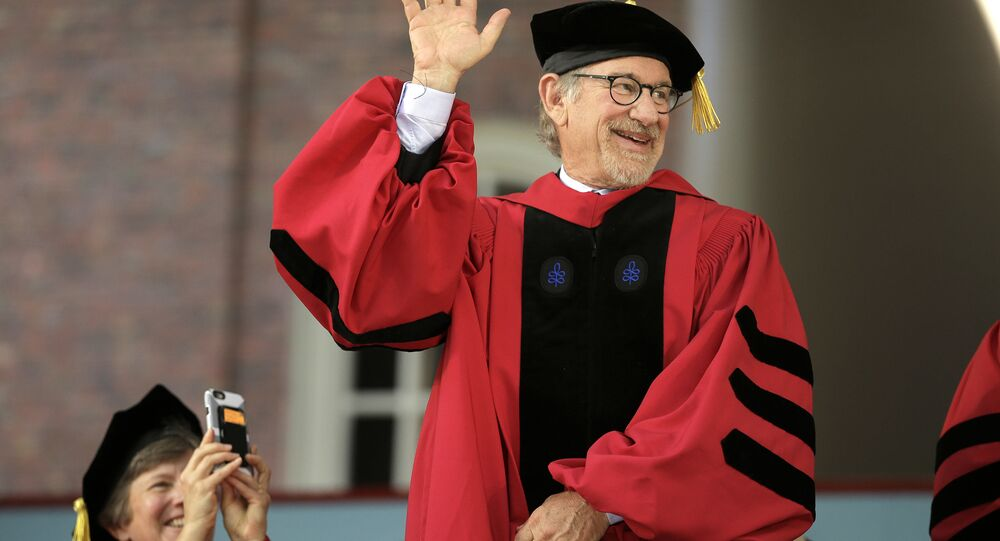 Filmmaker Steven Spielberg waves as he acknowledges applause before receiving an honorary doctor of arts degree during Harvard University commencement exercises, Thursday, May 26, 2016, in Cambridge, Mass