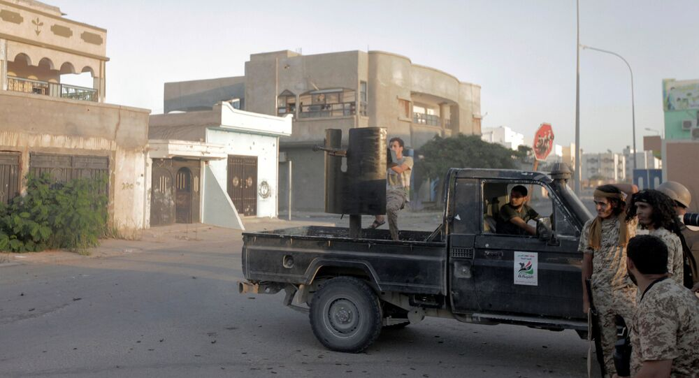 Fighters from Libyan forces allied with the U.N.-backed government take position during a battle with Islamic State fighters in Sirte, Libya August 21, 2016