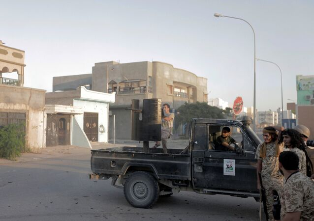 Fighters from Libyan forces allied with the UN-backed government take position during a battle with Daesh fighters in Sirte, Libya August 21, 2016