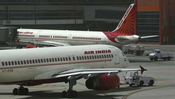 Air India planes are parked on the tarmac at the Terminal 3 of Indira Gandhi International Airport in New Delhi, India, Friday, May 18, 2012 - Sputnik International